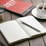 notebook,pen,2017 calendar,glasses and coffee cup on restro wooden desktop